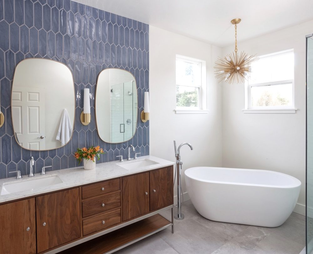 photo of a master bathroom with blue tile backsplash