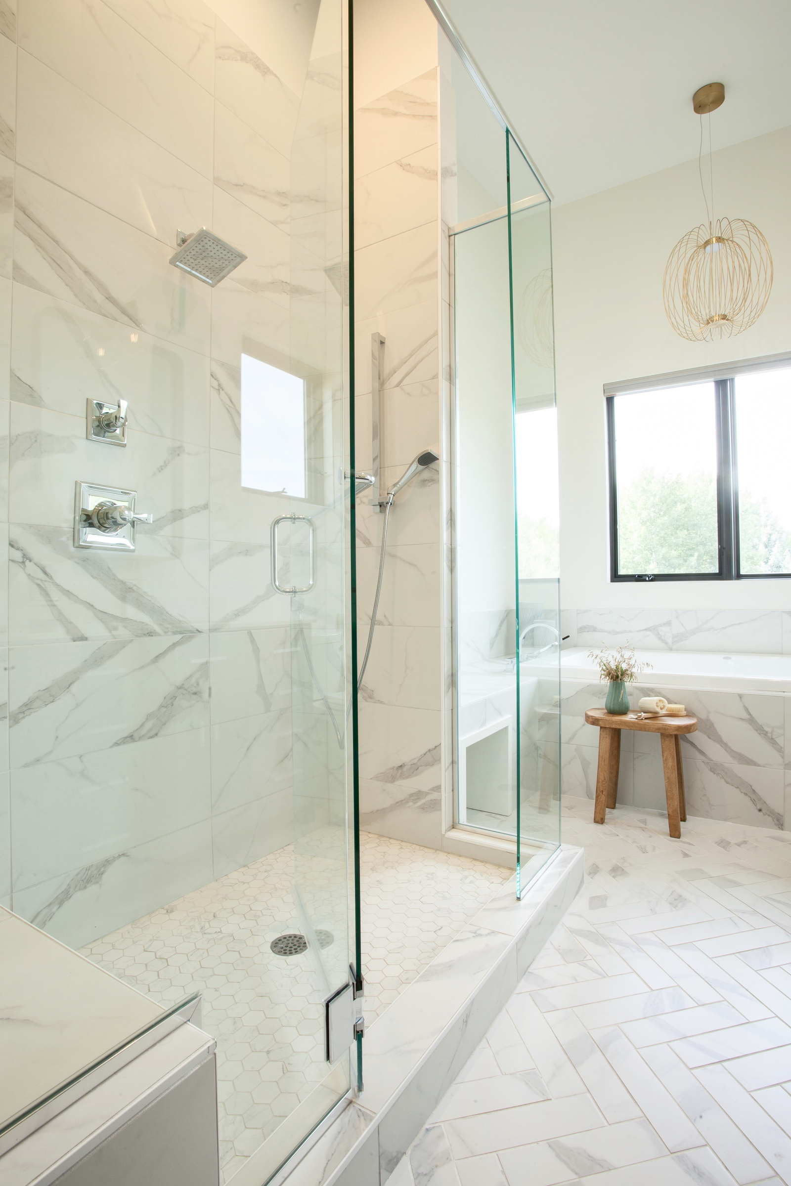 Shower in master bathroom with porcelain tile